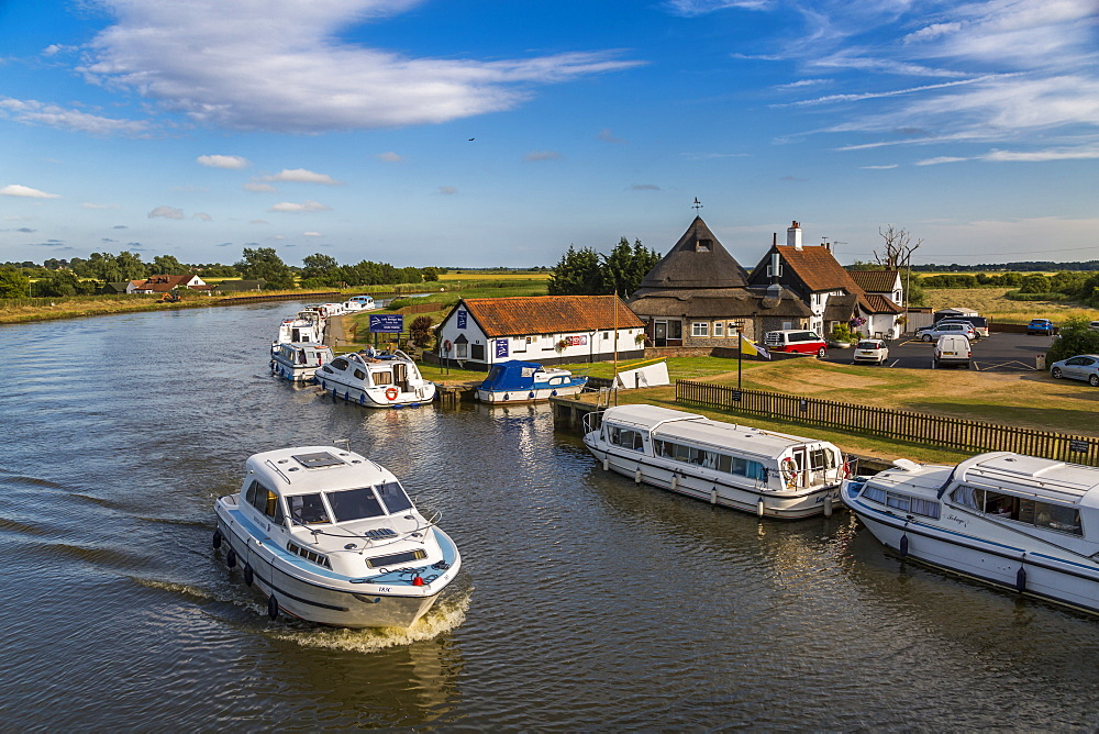 Boats on River Bure at Acle Bridge, Norfolk Broads, Norfolk, England, United Kingdom, Europe