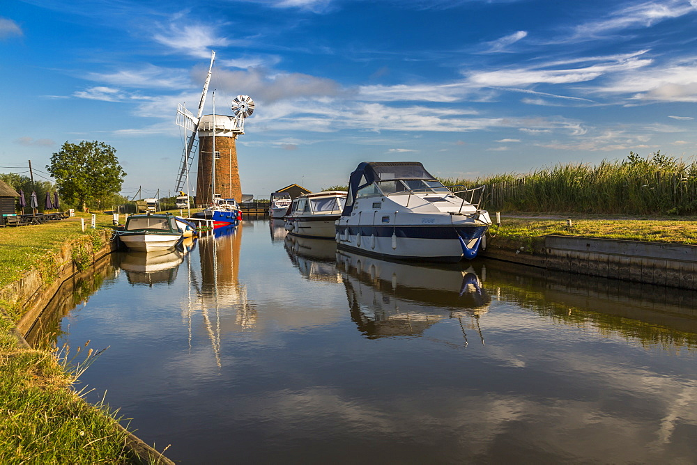 Boats and Horsey Mill reflecting in water, Norfolk Broads, Norfolk, England, United Kingdom, Europe