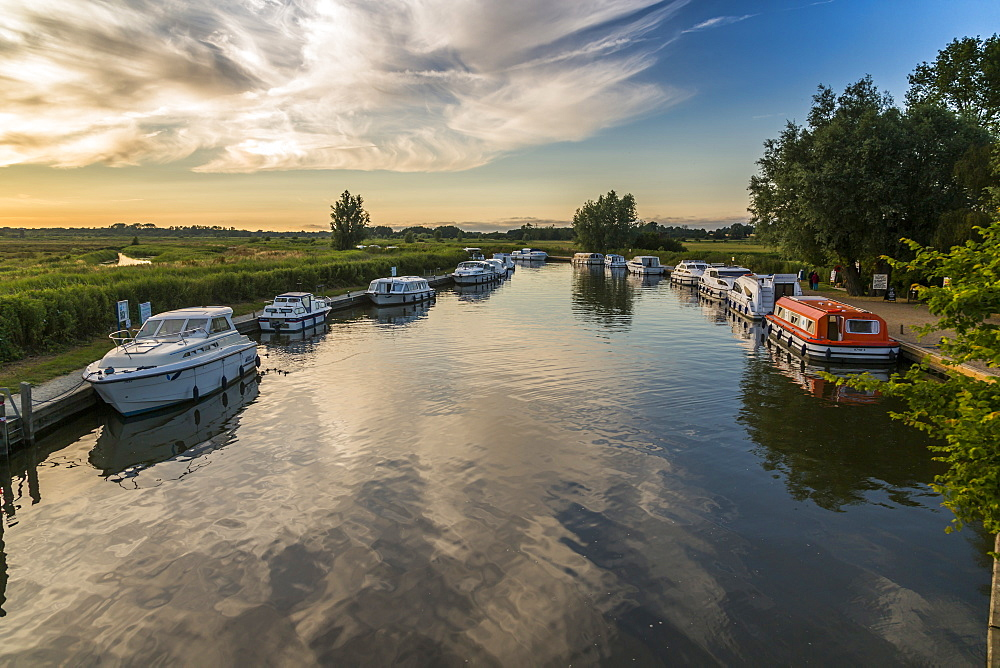 Boats and cottage near Horsey Mill at sunset, Norfolk Broads, Norfolk, England, United Kingdom, Europe