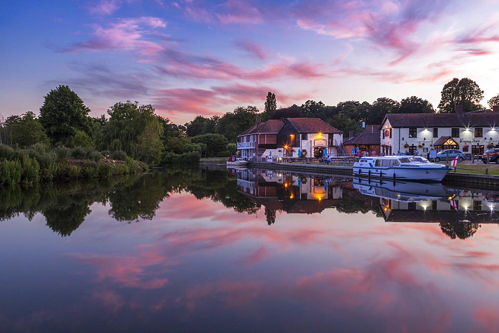 Boats on River Bure at Coltishall after sunset, Norfolk Broads, Norfolk, England, United Kingdom, Europe