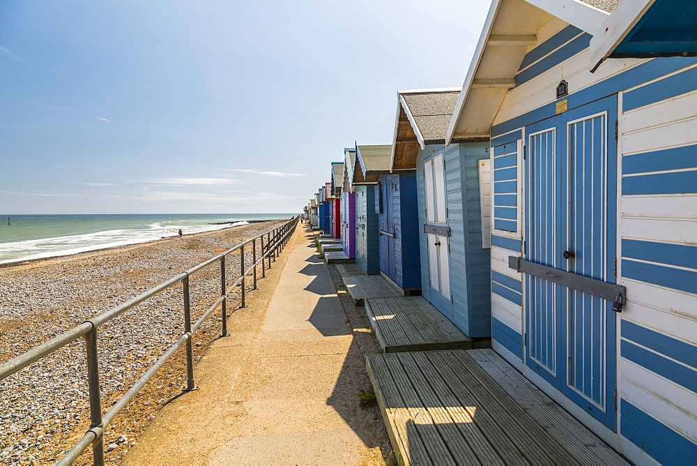 View of colourful beach huts on a summer day, Cromer, Norfolk, England, United Kingdom, Europe