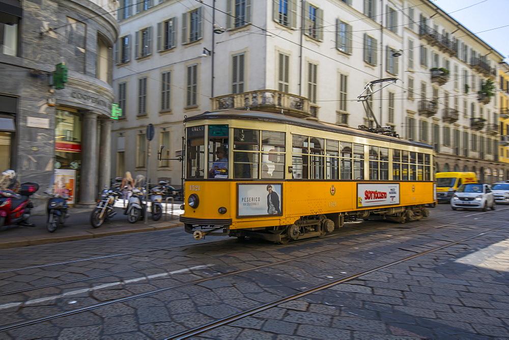 City tram passing on Via Alessandro Manzoni, Milan, Lombardy, Italy, Europe