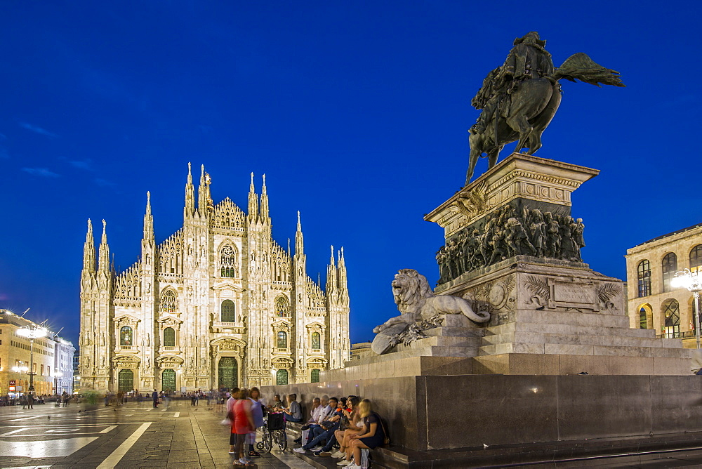 View of Duomo di Milano illuminated in Piazza Del Duomo at dusk, Milan, Lombardy, Italy, Europe