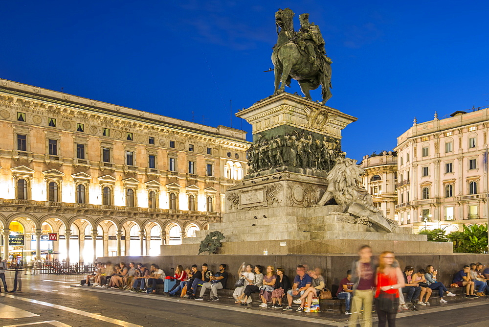 View of statue of Vittorio Emanuele II in Piazza Del Duomo at dusk, Milan, Lombardy, Italy, Europe
