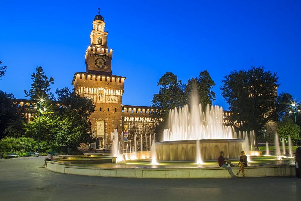 View of Castello Sforzesco (Sforza Castle and fountains at dusk, Milan, Lombardy, Italy, Europe