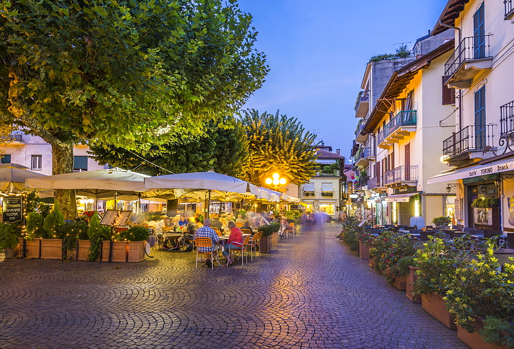 View of restaurants and souvenir shops in Stresa at dusk, Lago Maggiore, Piedmont, Italian Lakes, Italy, Europe