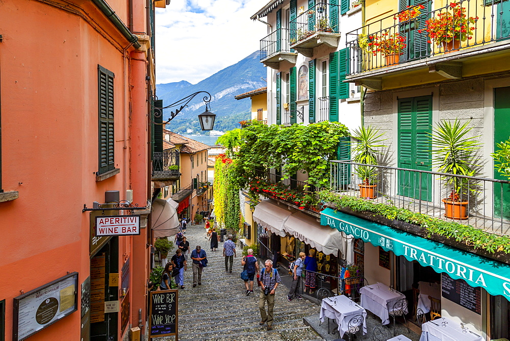 View of shops on cobbled street in Bellagio, Province of Como, Lake Como, Lombardy, Italian Lakes, Italy, Europe