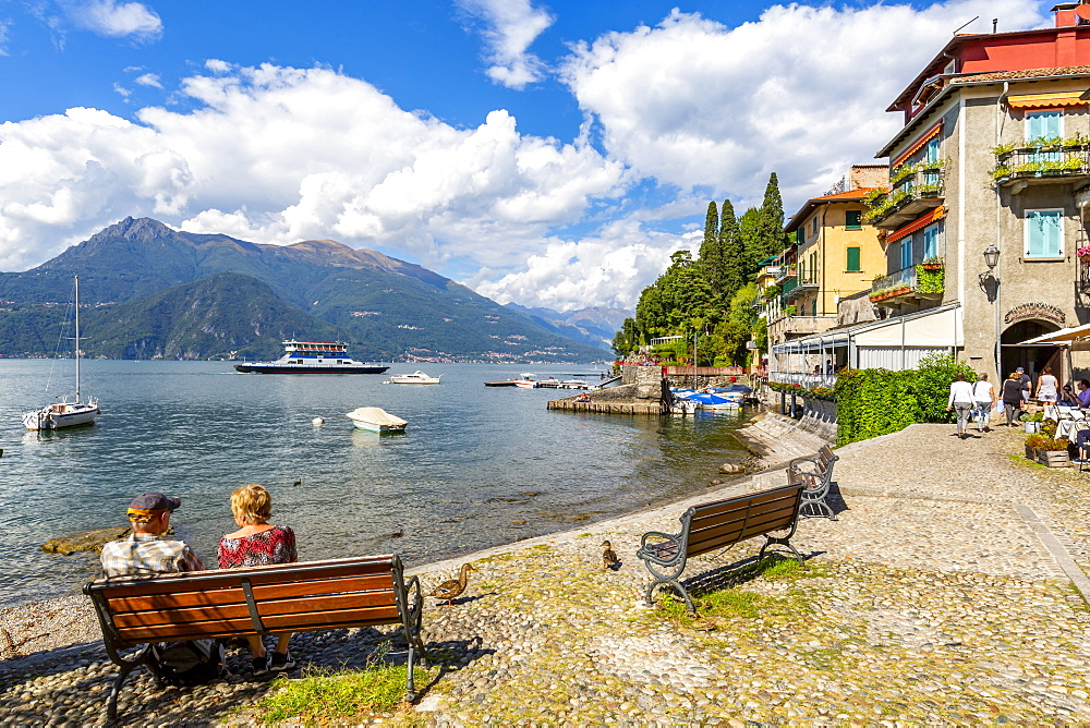 View of visitors on the lakeside in Vezio, Province of Como, Lake Como, Lombardy, Italian Lakes, Italy, Europe