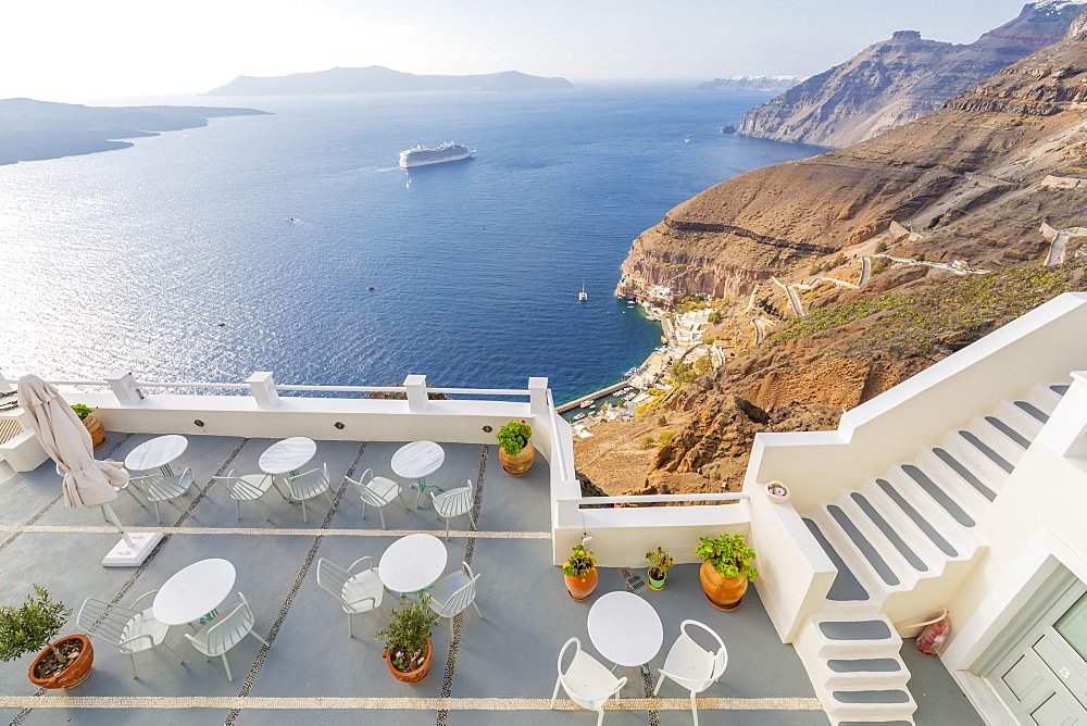 View of Fira white washed houses, harbour and cruise ship, Firostefani, Santorini (Thira), Cyclades Islands, Greek Islands, Greece, Europe