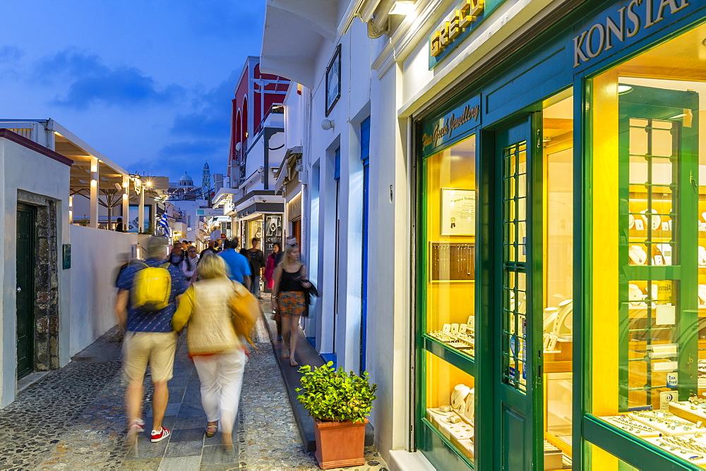 View of busy shopping street in Fita at dusk, Fira, Firostefani, Santorini (Thira), Cyclades Islands, Greek Islands, Greece, Europe