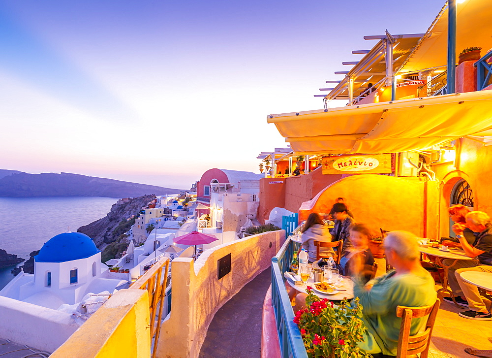 View of restaurant in Oia village overlooking the sea at dusk, Santorini, Cyclades, Aegean Islands, Greek Islands, Greece, Europe - 844-18029