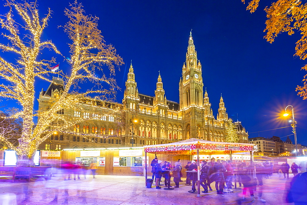 Rathaus and Christmas Market at night in Rathausplatz, Vienna, Austria, Europe