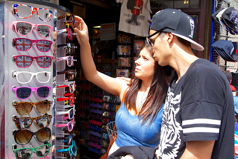 Young couple looking at sunglasses, London, England, United Kingdom, Europe