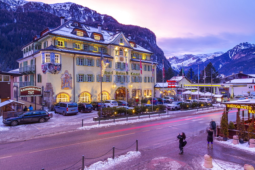 View of Hotel Dolomiti Canazei at dusk in winter, Canazei, Val di Fassa, Trentino, Italy, Europe