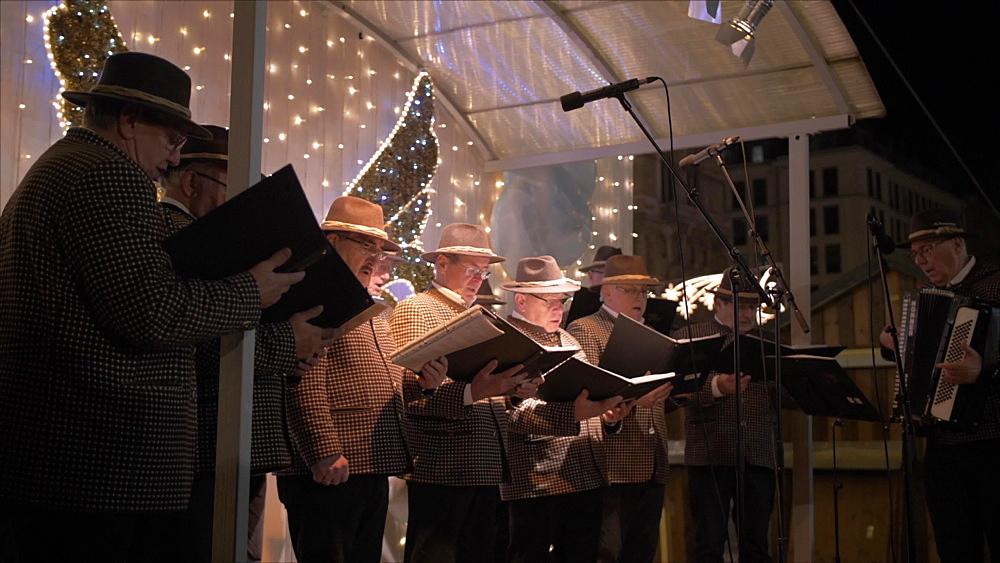 Shot of male voice choir on Rathausplatz at Christmas, Vienna, Austria, Europe