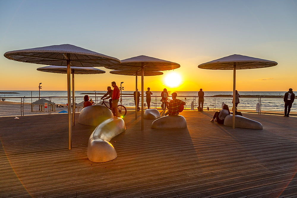 View of sunshades on promenade at sunset, Hayarkon Street, Tel Aviv, Israel, Middle East