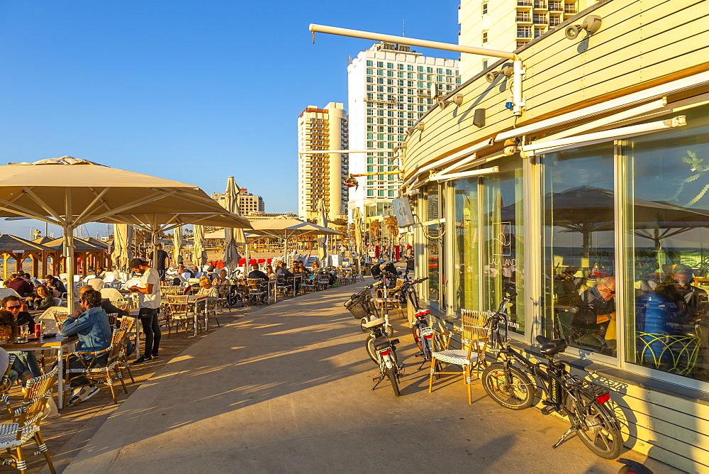 View of cafe restaurants on promenade, Hayarkon Street, Tel Aviv, Israel, Middle East