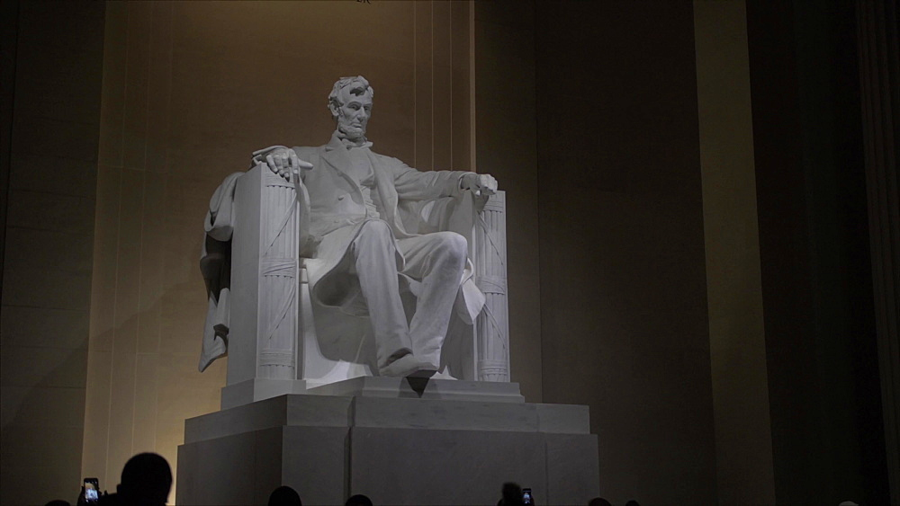 Pan shot of interior Lincoln Memorial at night, Washington DC, District of Columbia, USA, North America