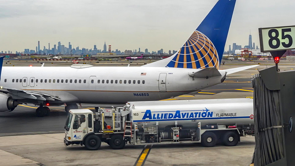 Time lapse of airplanes on runway at Newark Liberty International Airport, Manhattan skyline visible, New York, United States of America, North America
