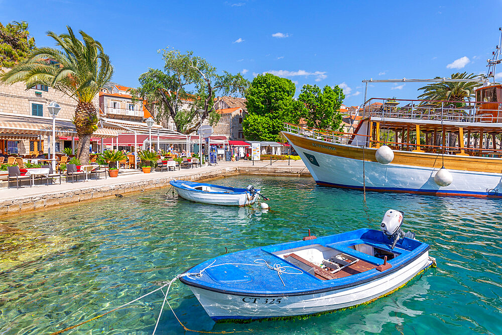 View of harbourside restaurants in Cavtat on the Adriatic Sea, Cavtat, Dubronick Riviera, Croatia, Europe