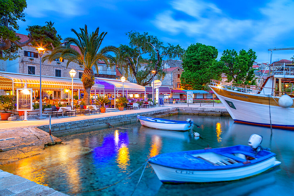 View of restaurants and harbour boats at dusk, Cavtat on the Adriatic Sea, Cavtat, Dubronick Riviera, Croatia, Europe