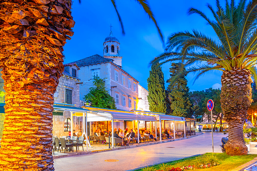 View of restaurants and church at dusk, Cavtat on the Adriatic Sea, Cavtat, Dubronick Riviera, Croatia, Europe