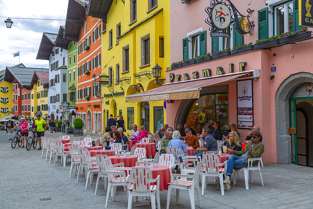 View of visitors enjoying drinks outside cafe on Vorderstadt, Kitzbuhel, Austrian Tyrol Region, Austria, Europe