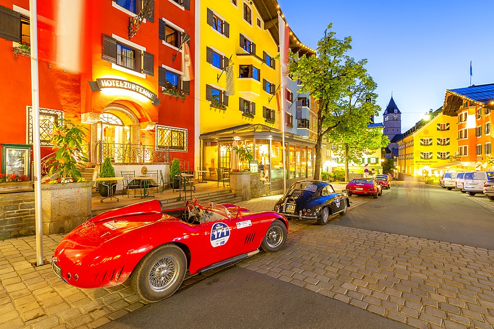 View of architecture and classic car on Vorderstadt at dusk, Kitzbuhel, Austrian Tyrol Region, Austria, Europe
