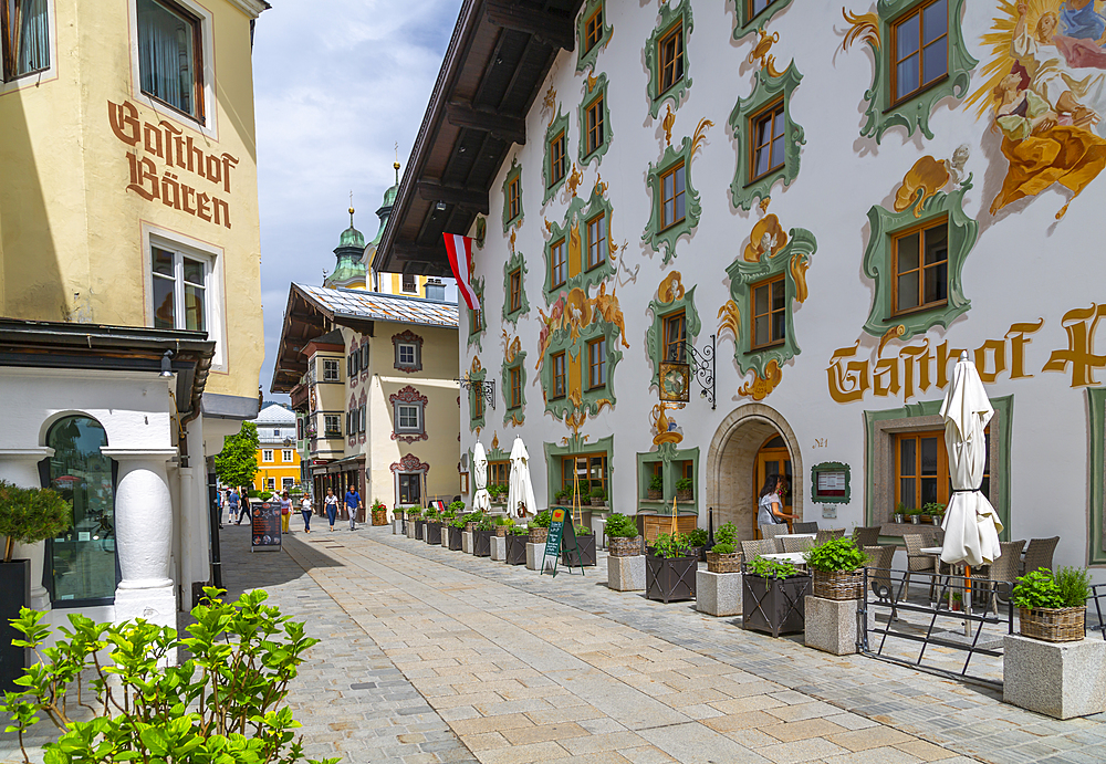 View of colourful architecture on Speckbackerstrassa in St. Johann in Tirol, Austrian Tyrol, Austria, Europe