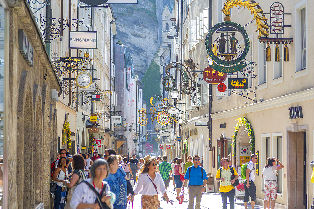 View of shoppers and signs on Getreidegasse, Salzburg, Austria, Europe