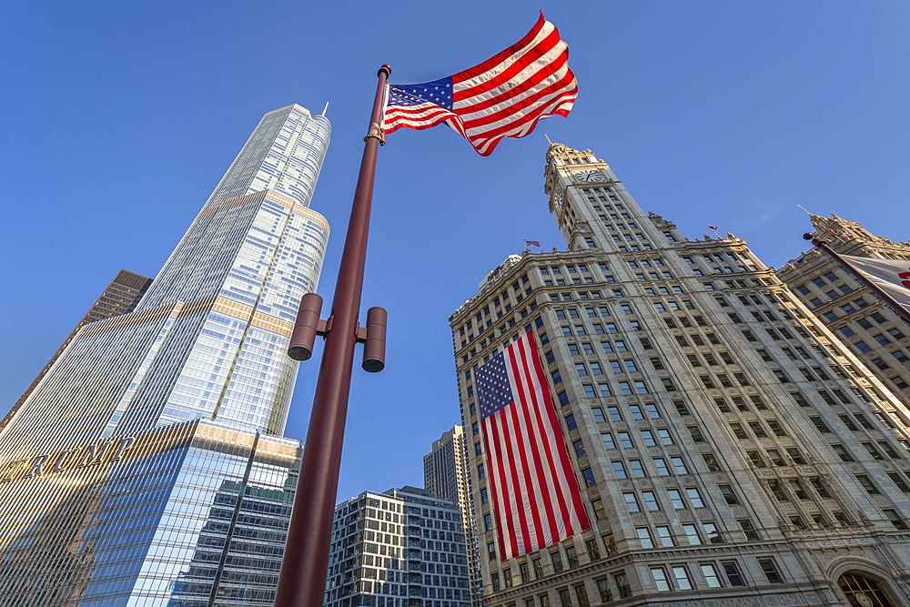 Early morning view of The Wrigley Building and Stars and Stripes US flag on DuSable Bridge, Chicago, Illinois, United States of America, North America