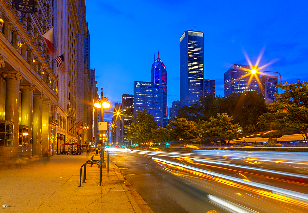 View of trail lights and skyscrapers on Michigan Avenue at dusk, Chicago, Illinois, United States of America, North America
