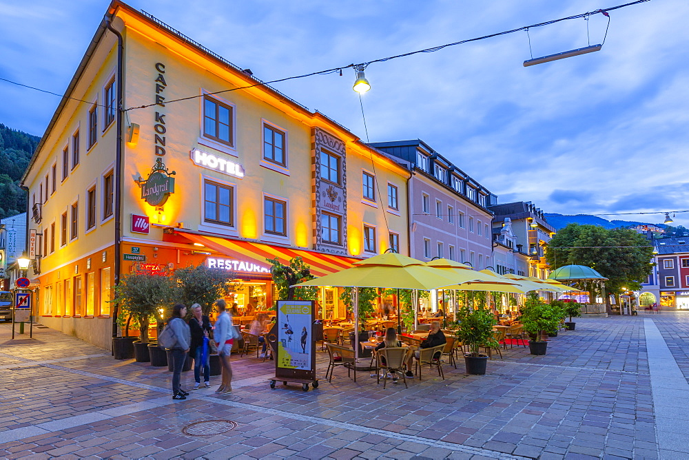 View of restaurant on Hauptplatz at dusk, Schladming town, Styria, Austrian Tyrol, Austria, Europe