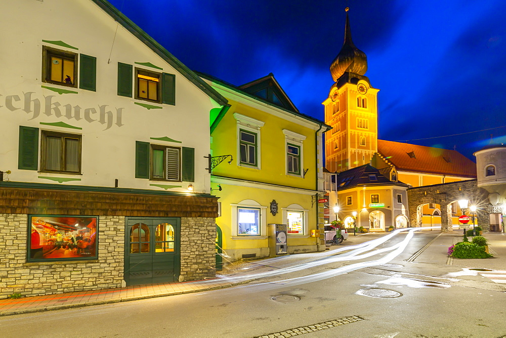 View of church and local buildings at dusk, Schladming, Styria, Austrian Tyrol, Austria, Europe