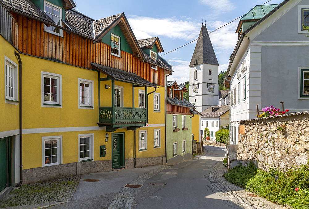 View of colourful buildings and church in Bad Aussie, Styria, Austria, Europe