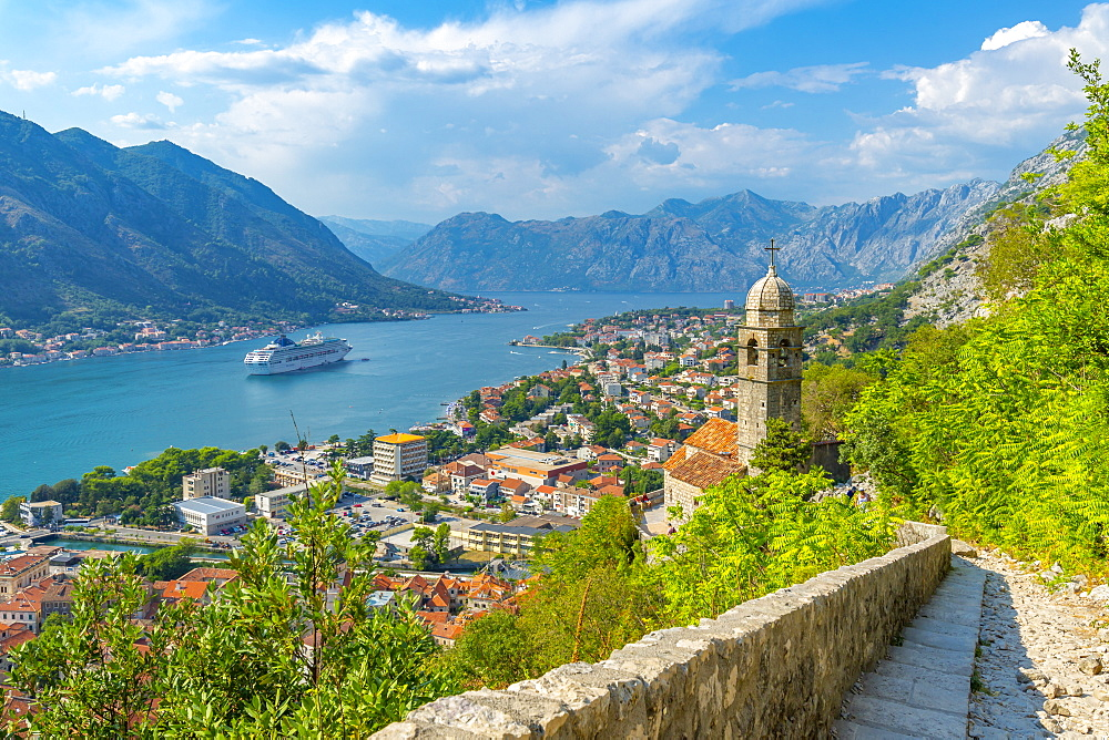 View of cruise ship and Chapel of Our Lady of Salvation overlooking the Old Town, UNESCO World Heritage Site, Kotor, Montenegro, Europe