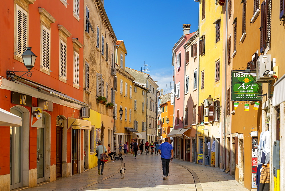 View of shops and people in colourful old town, Rovinj, Istria, Croatia, Adriatic, Europe