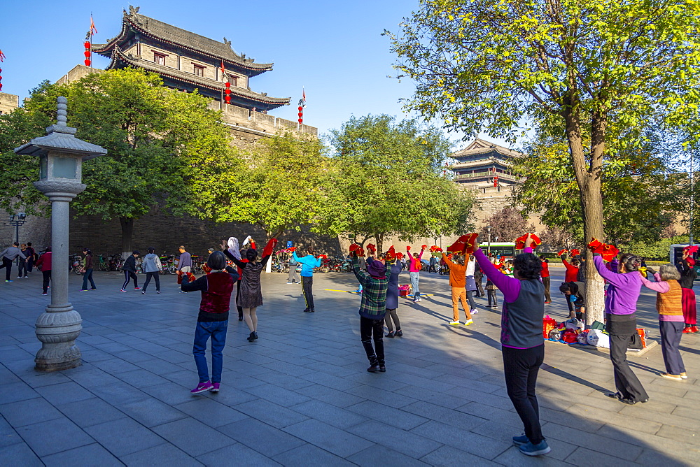 Locals performing Tai chi near City wall of Xi'an, Shaanxi Province, People's Republic of China, Asia - 844-21906