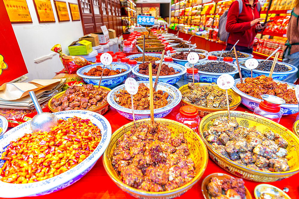 Local delicacies on display in Ciqikou Old Town, Shapingba, Chongqing, China, Asia