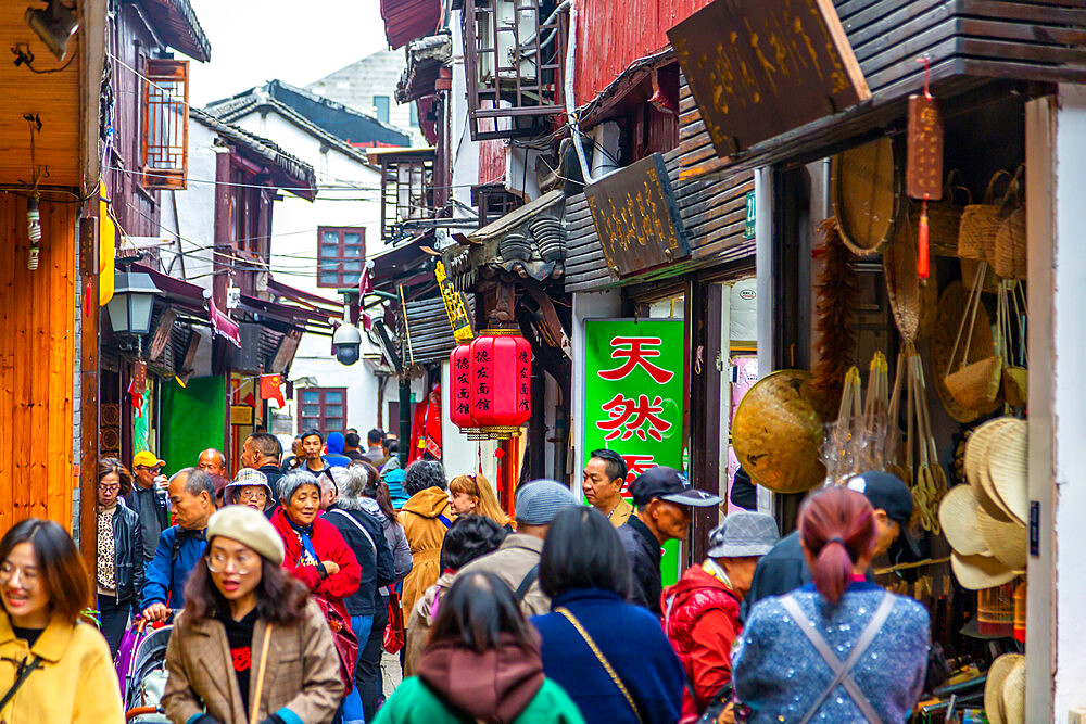 View of busy shopping street in Zhujiajiaozhen water town, Qingpu District, Shanghai, China, Asia