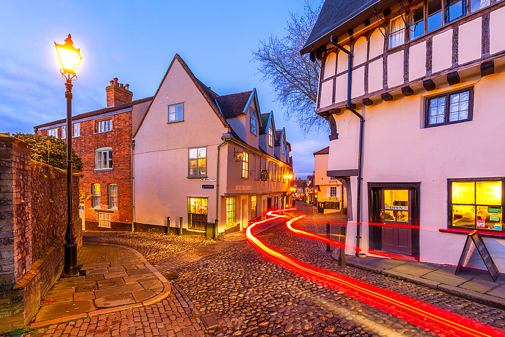 View of Elm Hill cobbled street and architecture at dusk, Norwich, Norfolk, England, United Kingdom, Europe