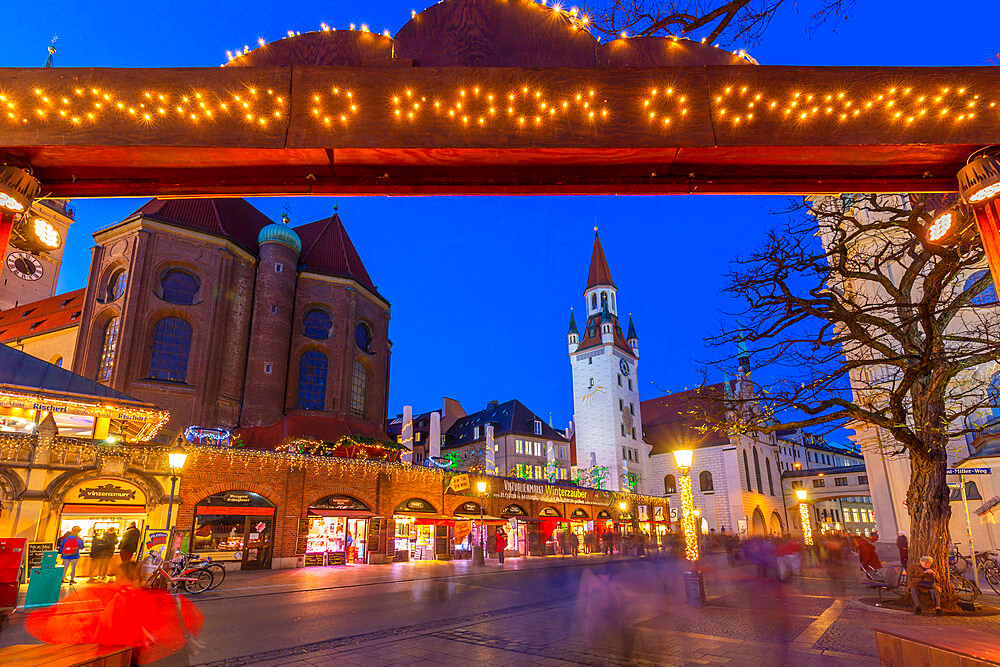 View of Old Town Hall and entrance to Viktualienmarkt Christmas Market at dusk, Munich, Bavaria, Germany, Europe