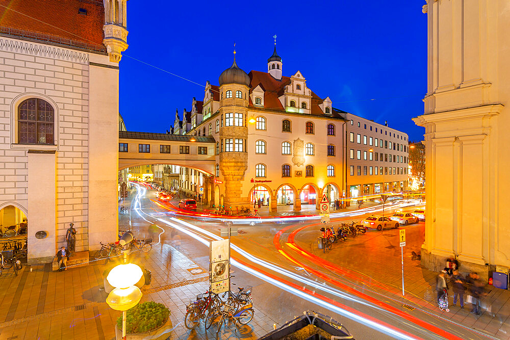 View of trail lights on street near Old Town Hall at dusk, Munich, Bavaria, Germany, Europe