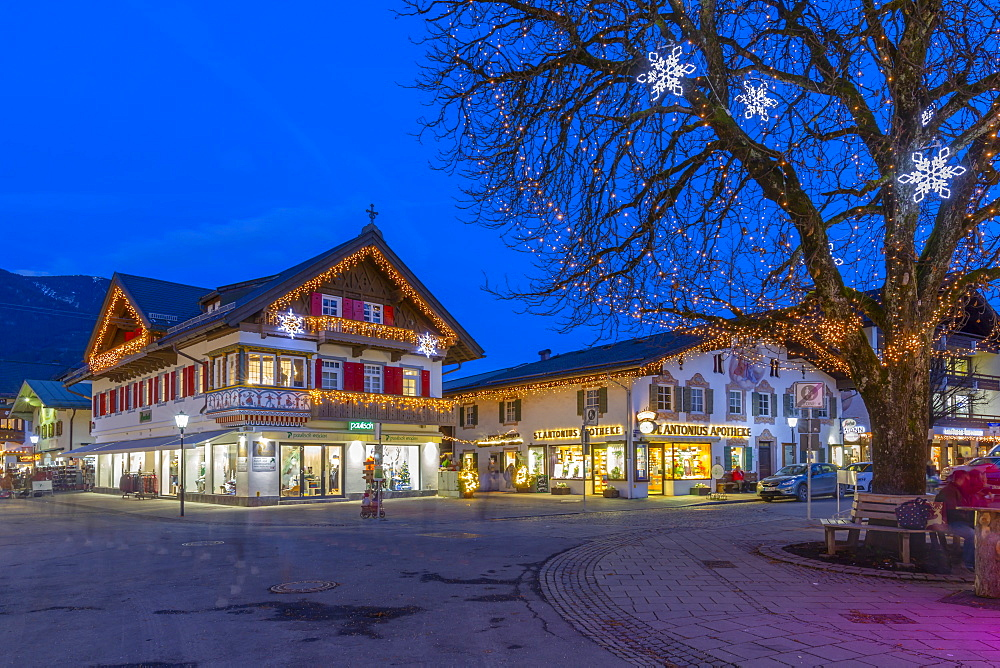 View of local shops in town at dusk, Garmisch-Partenkirchen, Bavaria, Germany