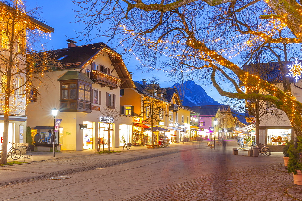 View of town shops at dusk, Garmisch-Partenkirchen, Bavaria, Germany, Europe