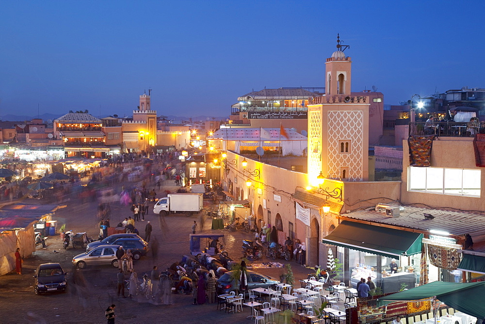 View over market square at dusk, Place Jemaa El Fna, Marrakesh, Morocco, North Africa, Africa