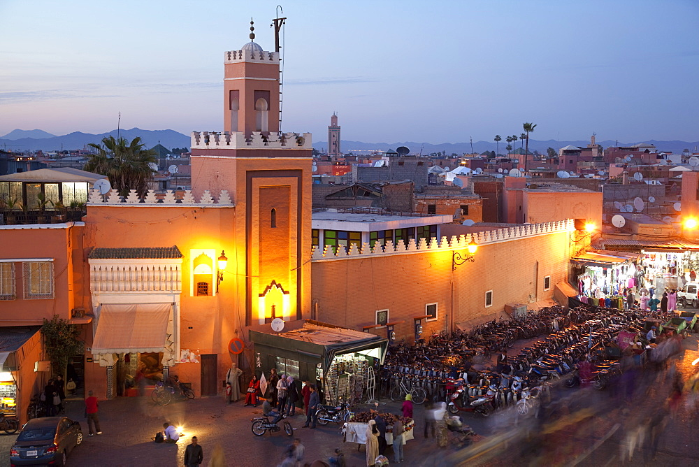 Mosque at dusk, Place Jemaa El Fna, Marrakesh, Morocco, North Africa, Africa