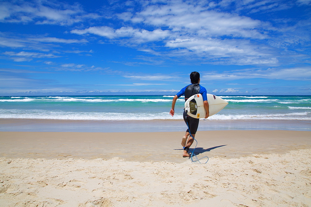 Surfers Paradise, Surfer heading for the sea, Gold Coast, Queensland, Australia, Oceania