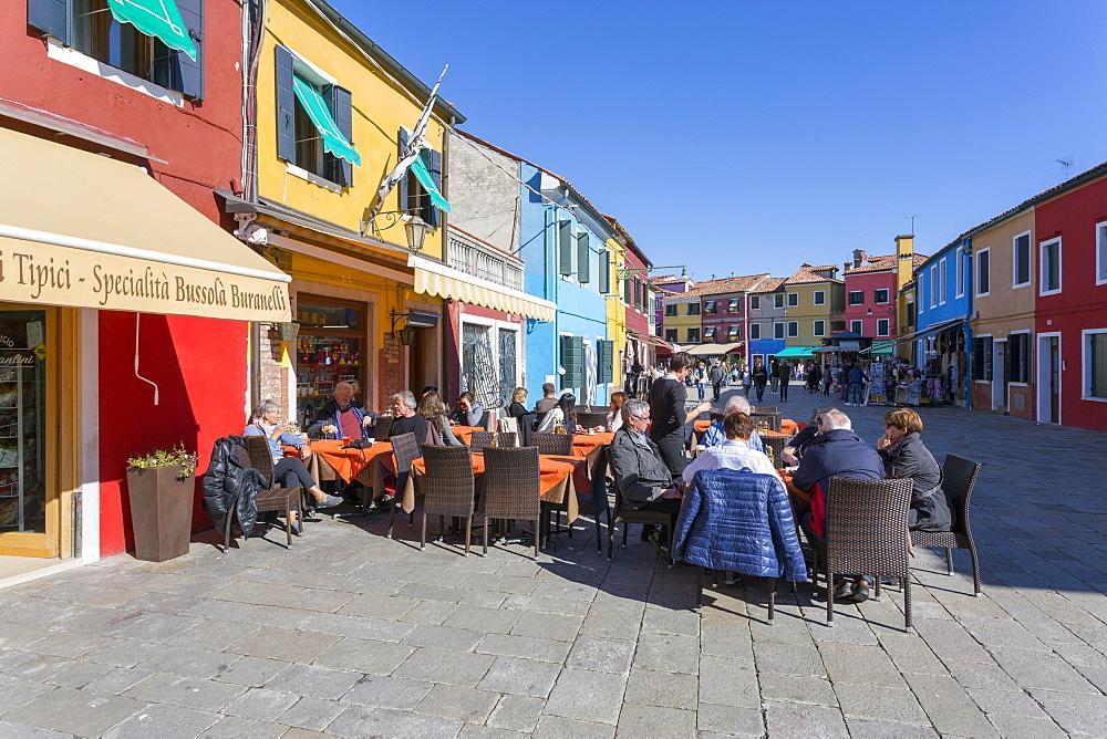 Restaurant and colourful facades, Burano, Veneto, Italy, Europe