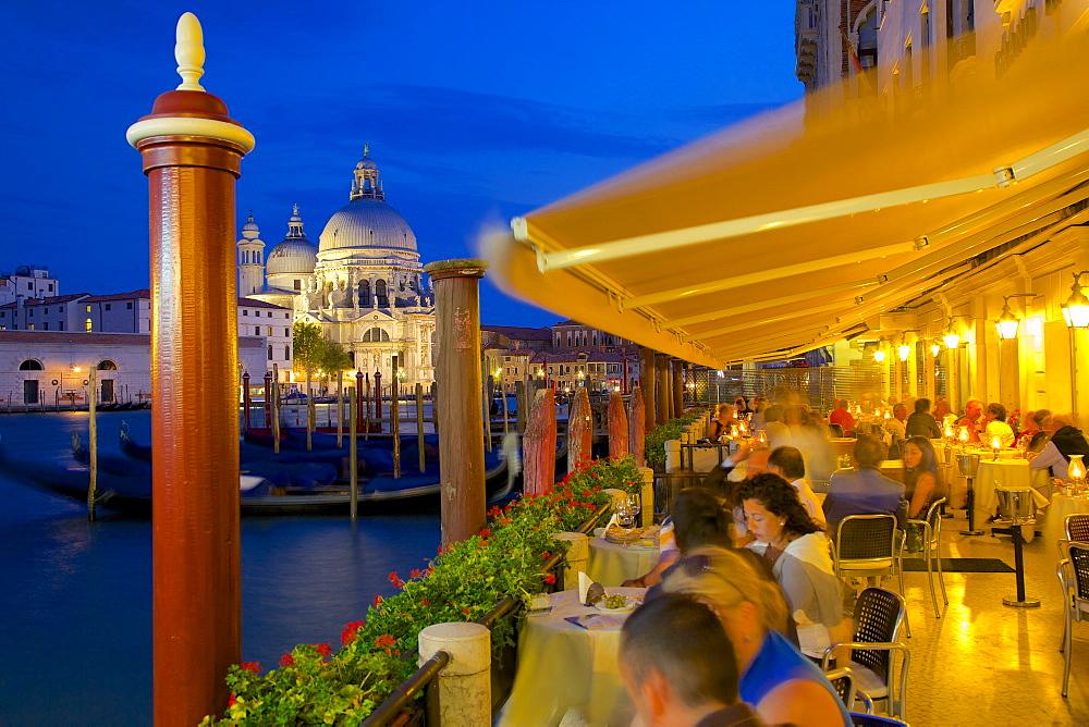 Santa Maria della Salute and restaurant at dusk, Dorsoduro, Venice, UNESCO World Heritage Site, Veneto, Italy, Europe